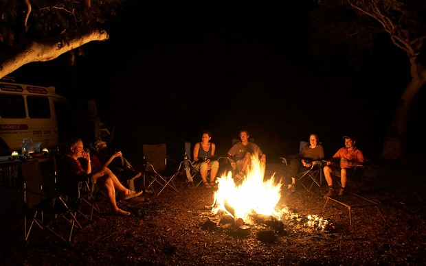 African Safari Experts campfire with guests 2015