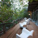A narrow deck in front of a guest suite at Kapama Karula