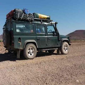 A vehicle on a raod in the desert