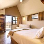 a bedroom with double bed and sliding doors