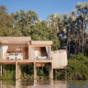 a guest suite on stilts hanging over a river