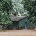 A small building amongst some trees at mana pools