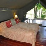 A double bed in a guest suite at Governers Private Camp