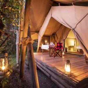 A tent at Mara Plains Camp with lanterns