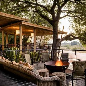 A burning fire on the main deck at Singita Ebony