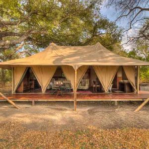 A luxury tent at Kadizora Camp set under trees'