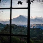 A mountain in the distance seen through a window