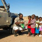 A guide from Doro Nawas with a group of children