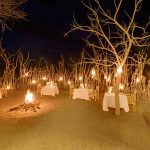 Traditional African boma with fire and dinner tables