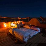 A star bed on top of one of the guest chalets at Little Kulala Lodge