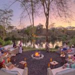 People sitting around a campfire on safari in Kenya