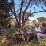 Guests enjoying a picnic in the bush