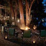 Riverside fireplace at night with a blazing fire next to the Zambezi River