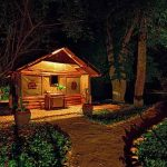 A chelt at night lit up at Ishasha Wilderness Camp