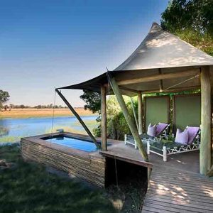 A guest tent and plunge pool on the edge of the Okavango at Xaranna