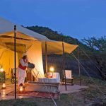 A tent lit up at night in the classic safari style