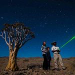 A guest is shown the stars byt a guide from Little Kulala Lodge