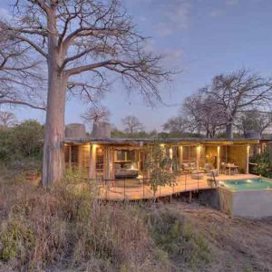 A house set amongst boulders in the African bush