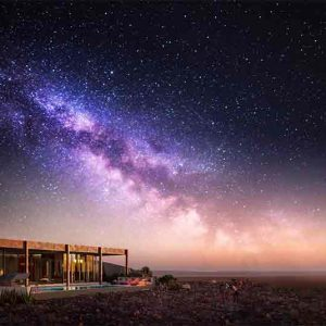 Desert and Dunes lodge at night under starry sky