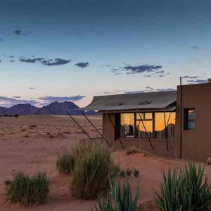 A small house on the edge of a desert in Namibia