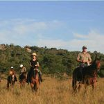 Several people on horse back in Mburo park