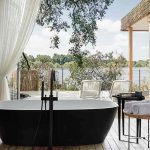 A bathtub in a guest suite overlooking the Zambezi River