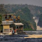 A large boat approaching the Murchison waterfalls on the Nile River