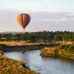 A hot air balloon flying over the Masai Mara close to Little Governers Camp