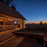 A dining deck at sunset at Chitabe