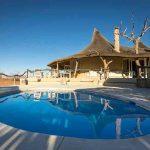 A swimming pool close to the main lodge of Little Kulala Lodge