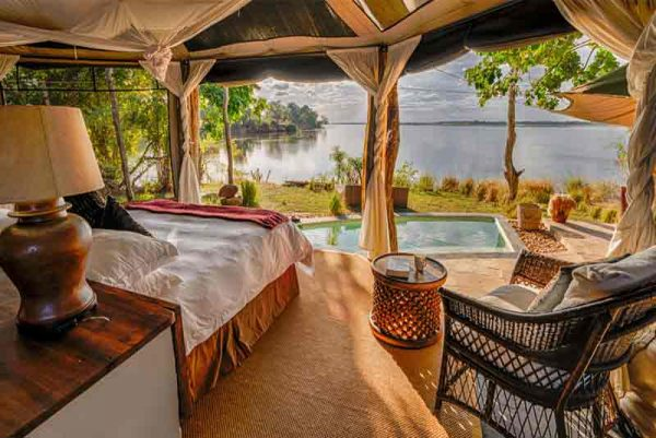 interior of a room with double bed looking out over a river