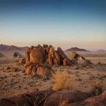 a large rock formation in a desert