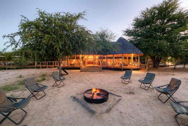 Campfire in front of a lodge in the desert
