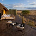 A veranda with beds on it for guests to sleep under the stars