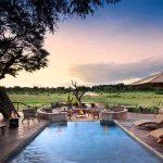 Swimming pool and view over Hwange at Somalisa Acacia