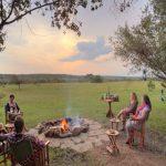 Encounter Mara guests at campfire