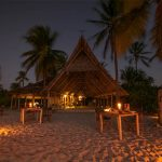 Fanjove restaurant at night with dining tables on the beach