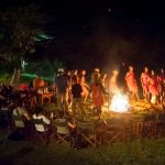 Guests at Ilkeliani dancing around the fire at night