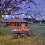 Kimondo camp outdoor dining experience under trees