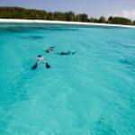 Matemwe lodge guest snorkeling in the ocean