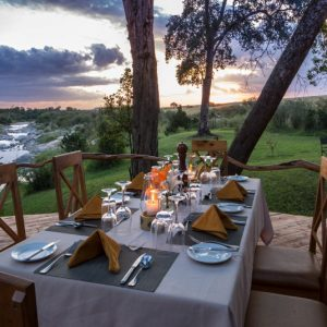 Rekero camp dining deck overlooking the Talek River in the Masai Mara
