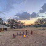Ubuntu Camp guests enjoying sunset drinks on the open plains